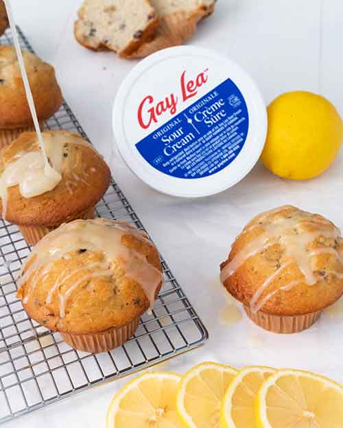 Lemon Muffin with a tub of Gay Lea Sour Cream