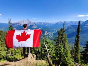 An image of a man holding a Canadian Flag