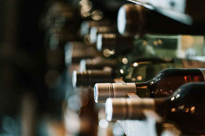 Picture of wine bottles in a cellar